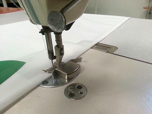 lavorazione bordatura tessuto